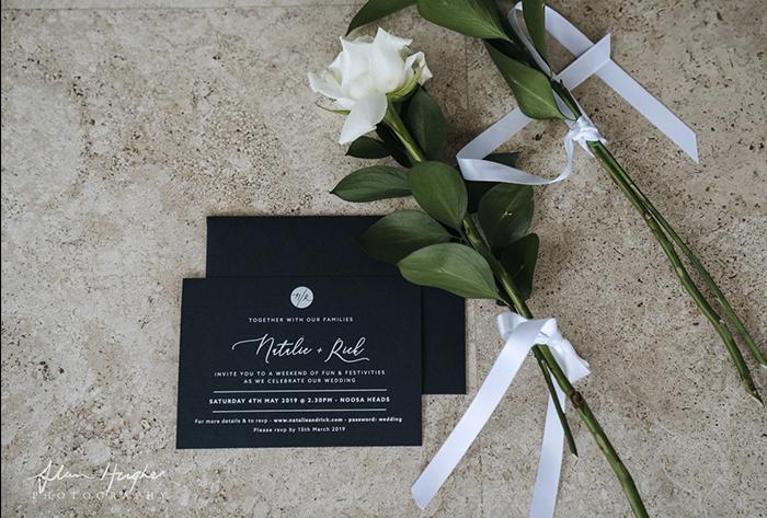 white ink printing on navy invitations