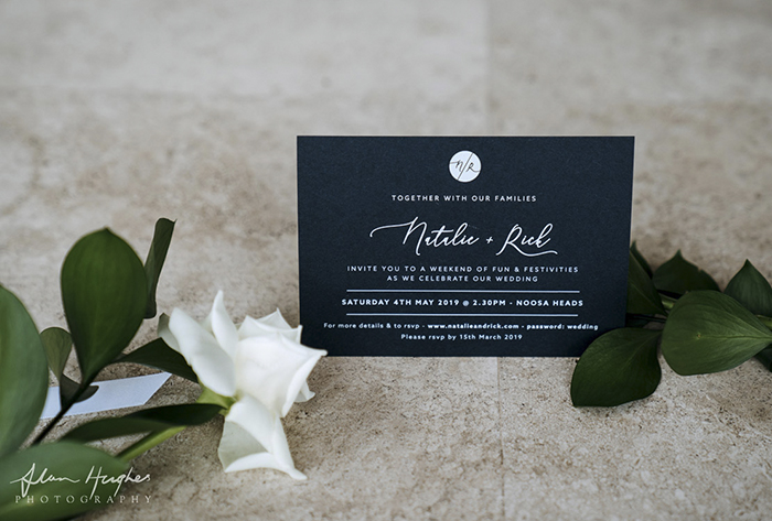 white ink printing on navy invitation