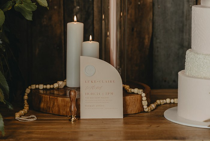 arch invitation with wax seal