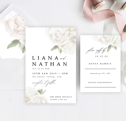 white floral invitations